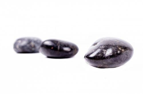 Black Stones On White Background