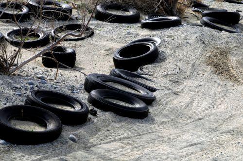 Black Tires In White Sand