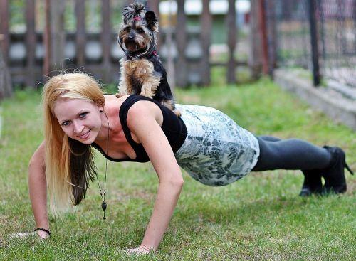 blonde woman yorkie dog