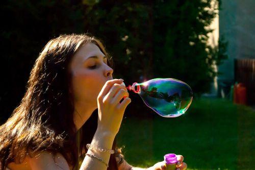 blowing soap bubbles bubbles