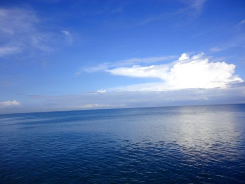 blue clouds deep ocean