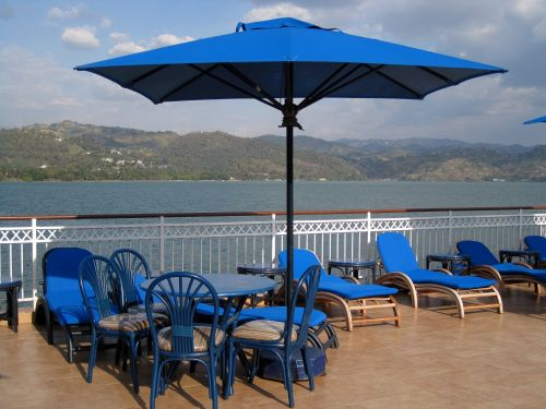 Blue Parasol & Chairs At Lake Side