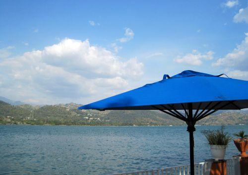 Blue Parasol And Lake