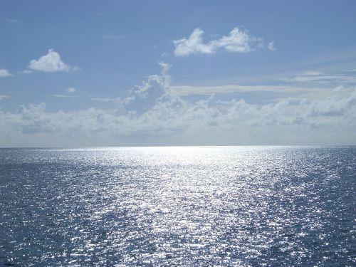 blue sea clouds clear skies