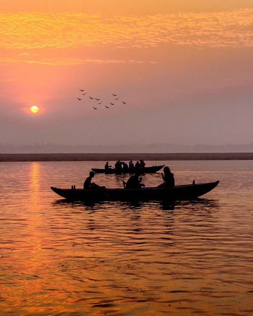boat river sunrise