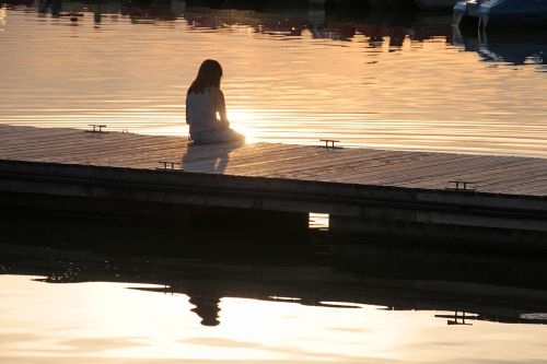 boat dock,girl,human,child,nature,person,water,joy of life,love of nature,outdoor nature,romantic,favorite place,thinking,meditation,silent,relax,experience nature,rest,feel nature,evening sun,summer evening,sunlight,mood,light,sunbeam,back light,golden,atmospheric