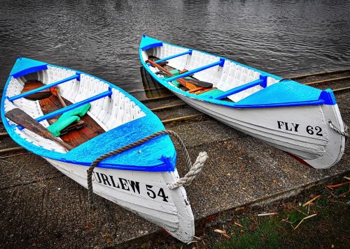 boats moored blue