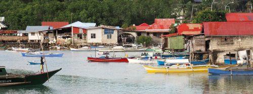 boats stilt houses river bank