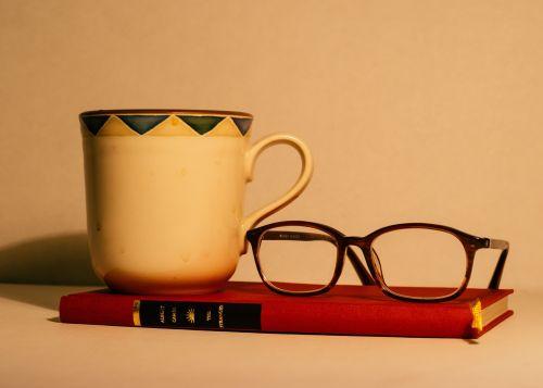 book eyeglasses mug