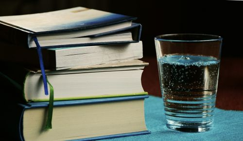 books book stack water glass