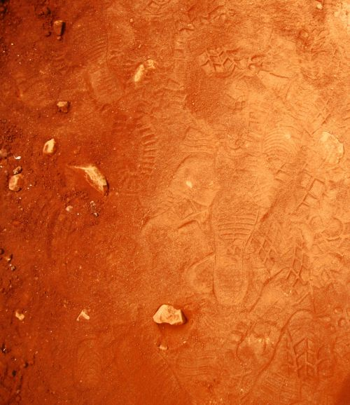 Bootprints In Loose Red Soil