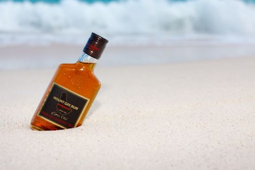 Bottle Of Rum On The Beach