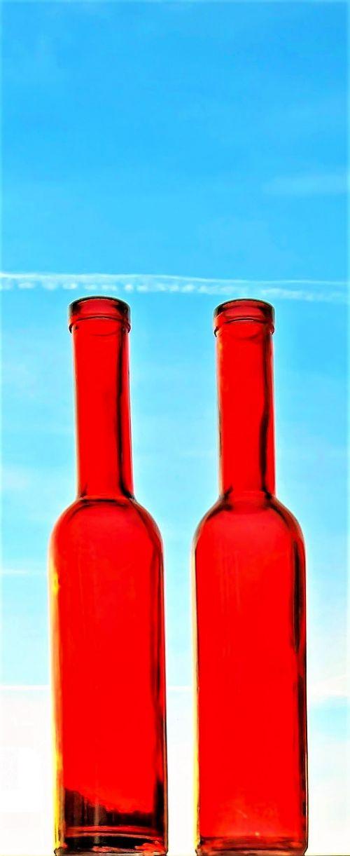 bottles red glass bottles blue sky