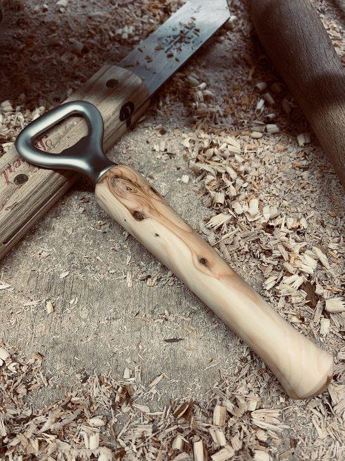 bottles opener  wooden handle  wood chips