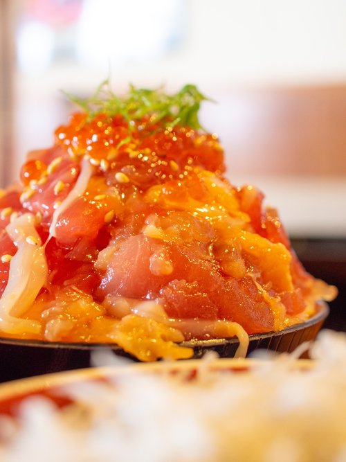 bowl of rice topped with sashimi  lunch  bowl