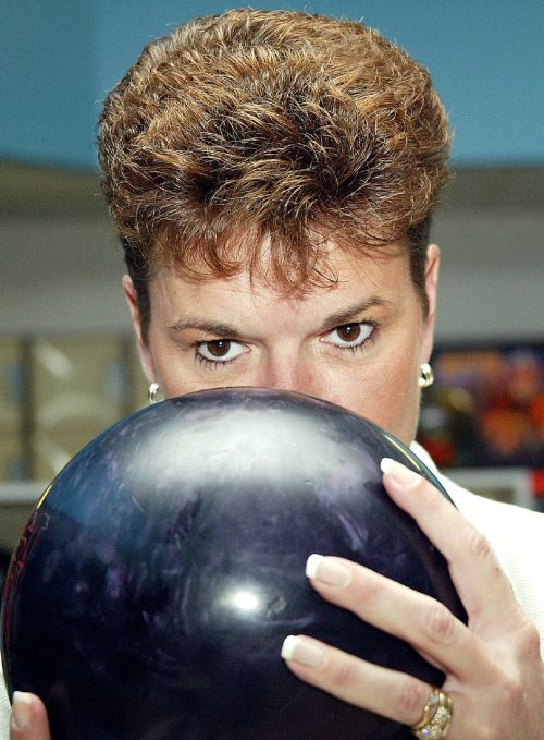 bowler concentrating woman