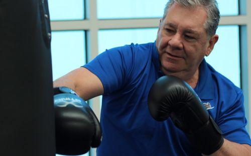 boxing punching old man
