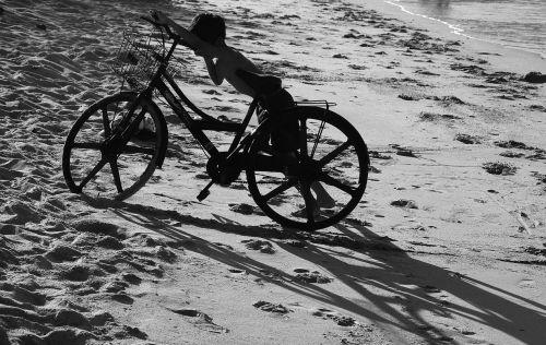 boy bike sand