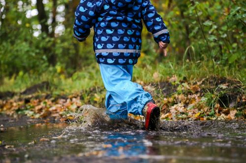 boy puddle autumn