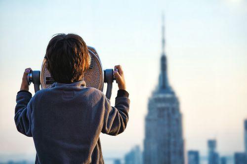 boy building coin operated binoculars