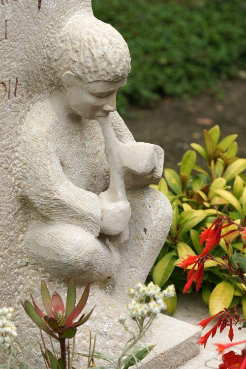 boy flautist cemetery