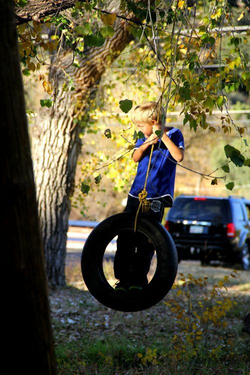 boy tire swing swinging