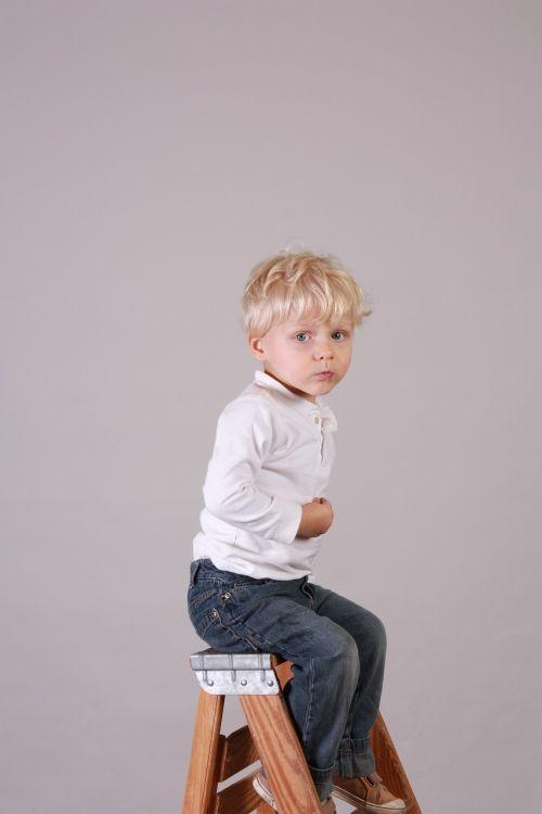 boy smiling sitting