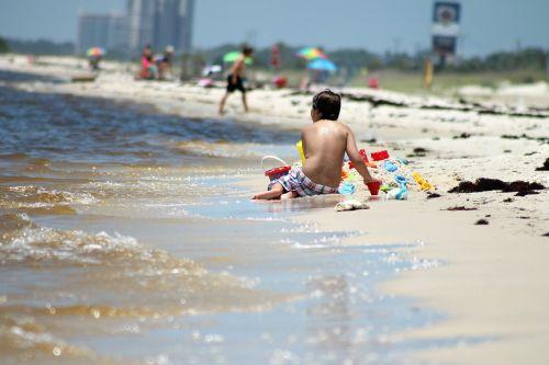 boy beach playing in sand