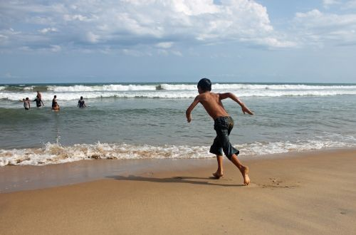 boy running beach
