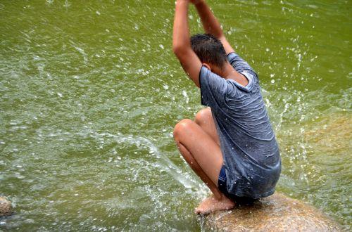 Boy Splashing