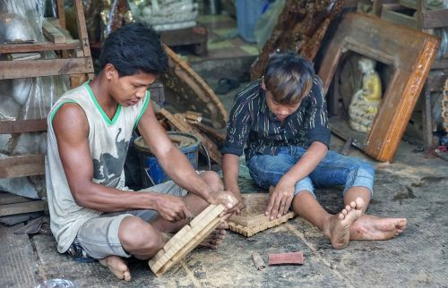 boys wood carving