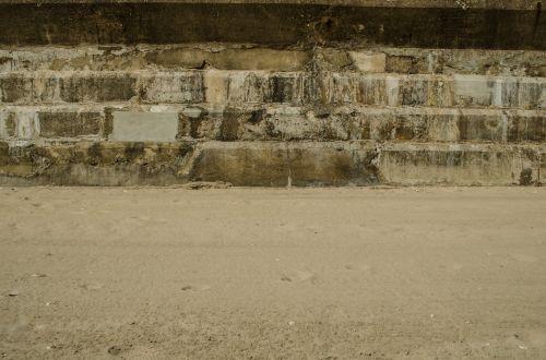 Brick Wall And Sand