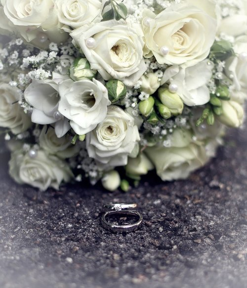 bridal bouquet  wedding rings  wedding