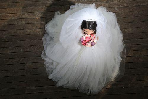 bride bride in wedding dress bride with flowers