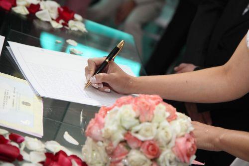 bride signing wedding signature signature