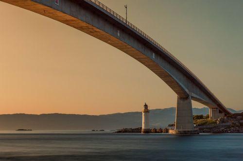 bridge lighthouse sunset