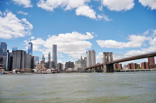 bridge,sun,manhattan,brooklyn,new york,architecture,downtown,view,skyscraper,york,city,building,skyline,river,water,sky,blue,clouds,town,tourism,construction