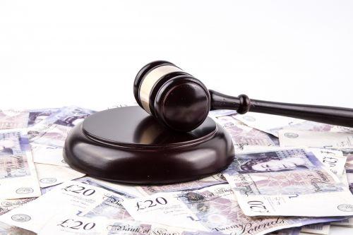 British Pounds And Judge's Gavel
