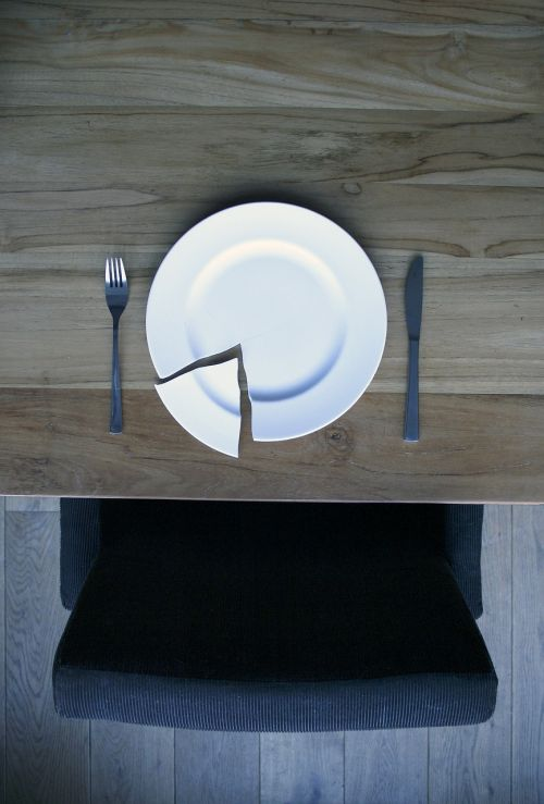 broken plate on a wooden table plate china