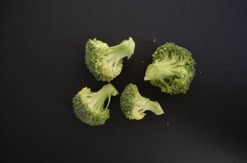 brokoli vegetables black background
