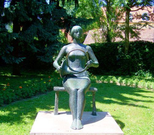 bronze statue feminine instrument siklós
