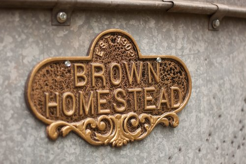 brown  homestead  sign