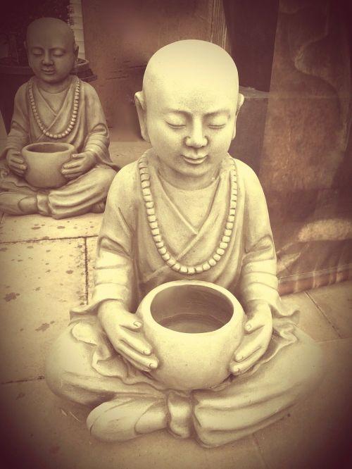 buddha monk stone figure