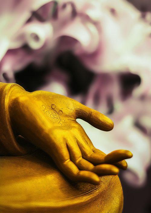buddha statue stone hand