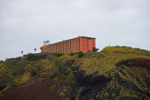 building,hotel,mountain,red,hotel las aguilas,las aguilas,puerto de la cruz