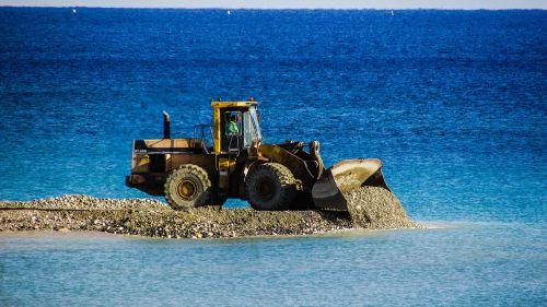 bulldozer unload gravel