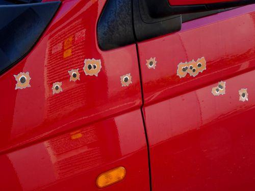 Bullet Holes On Car