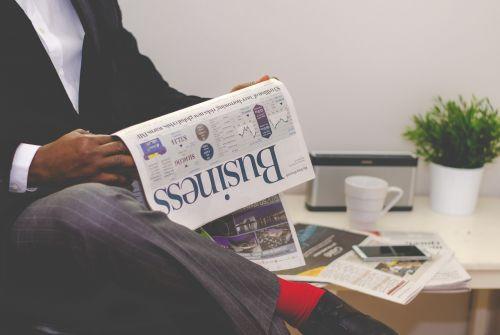 business man newspaper business