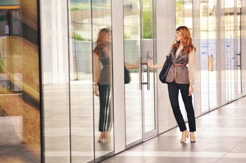 business woman opening door business woman portrait outdoors business center