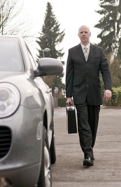 businessman porsche luggage